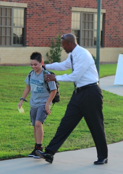 principal walking with student