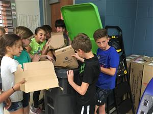 Students recycling cardboard