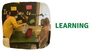 teacher teaching student how to care for plants