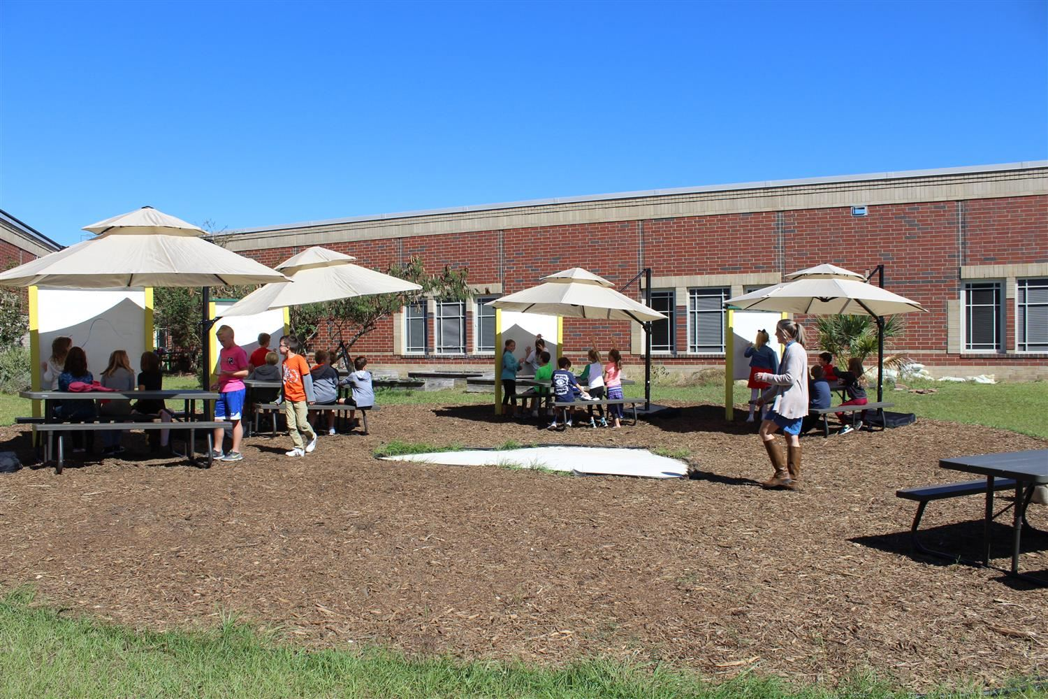 students learning in outdoor classroom